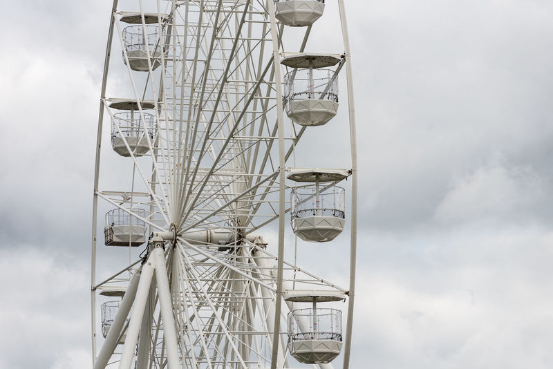 A large town centre ferris wheel with empty capsules on a cloudy day. Stratford on Avon, Warwickshire. Stratford On Avon Stratford-upon-Avon Amusement Park Amusement Park Ride Big Wheel Cloud - Sky Day Empty Ferris Wheel No People Observation Wheel Outdoors Ride Sky Town Centre