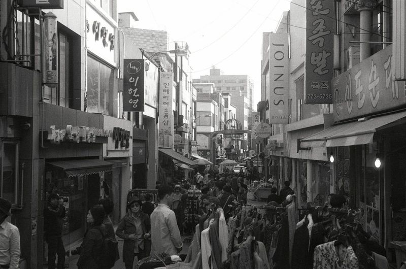 a marketplace Filmphotography Monochrome Fomapan400 Contaxiia Building Exterior City Architecture Built Structure Street Skyscraper Building Day Residential District City Life Outdoors City Street Sky