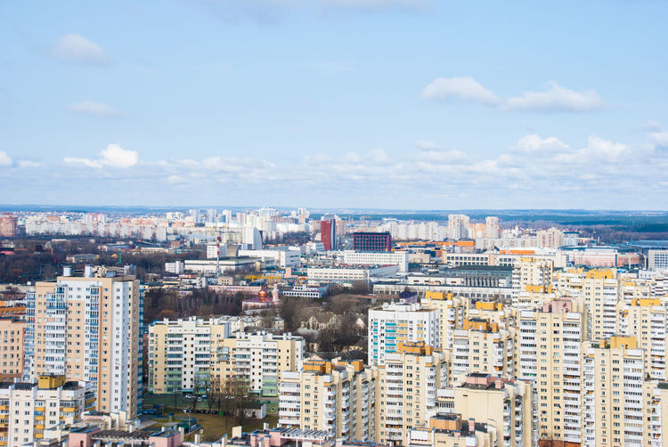Aerial View Of Cityscape By Sea Against Sky