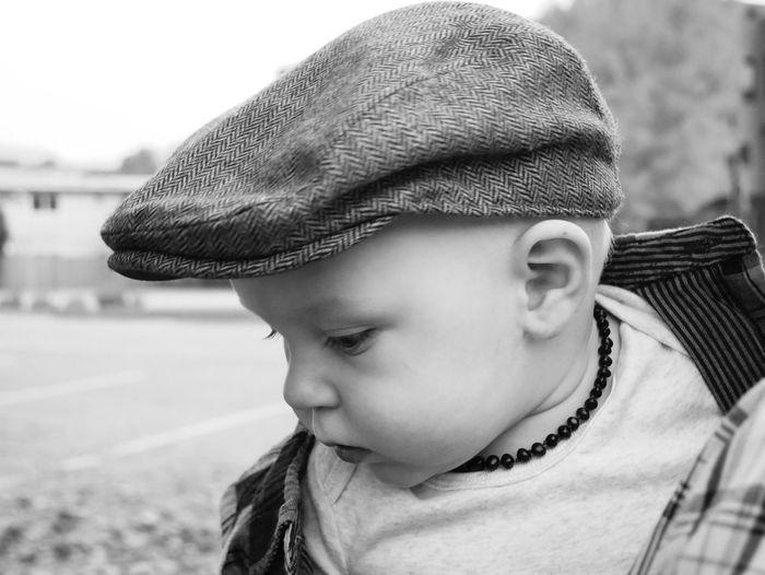 Close-up of boy wearing flat cap