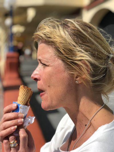 Close-up side view of woman eating ice cream