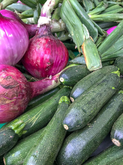 Farmers Market Red Onions Zucchini Close-up Day Food Food And Drink For Sale Freshness Full Frame Green Color Healthy Eating High Angle View Market Market Stall No People Organic Purple Raw Food Retail  Sale Still Life Street Market Vegetable Wellbeing
