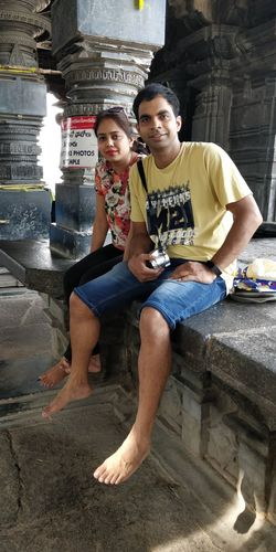resting me and wifey Portrait Full Length Sitting Togetherness Bonding Young Women Smiling Men Childhood Young Couple Husband Wife