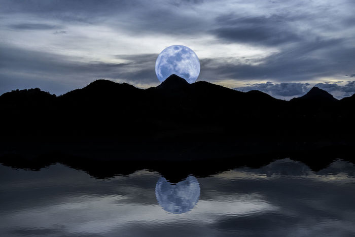 Beauty In Nature Blue Moon Cold Cold Temperature Full Moon Geology Horizon Over Water Idyllic Majestic Moon Moonrise Mountains Nature Outdoors Physical Geography Scenics Sea Silhouette Sky Tranquil Scene Tranquility Water