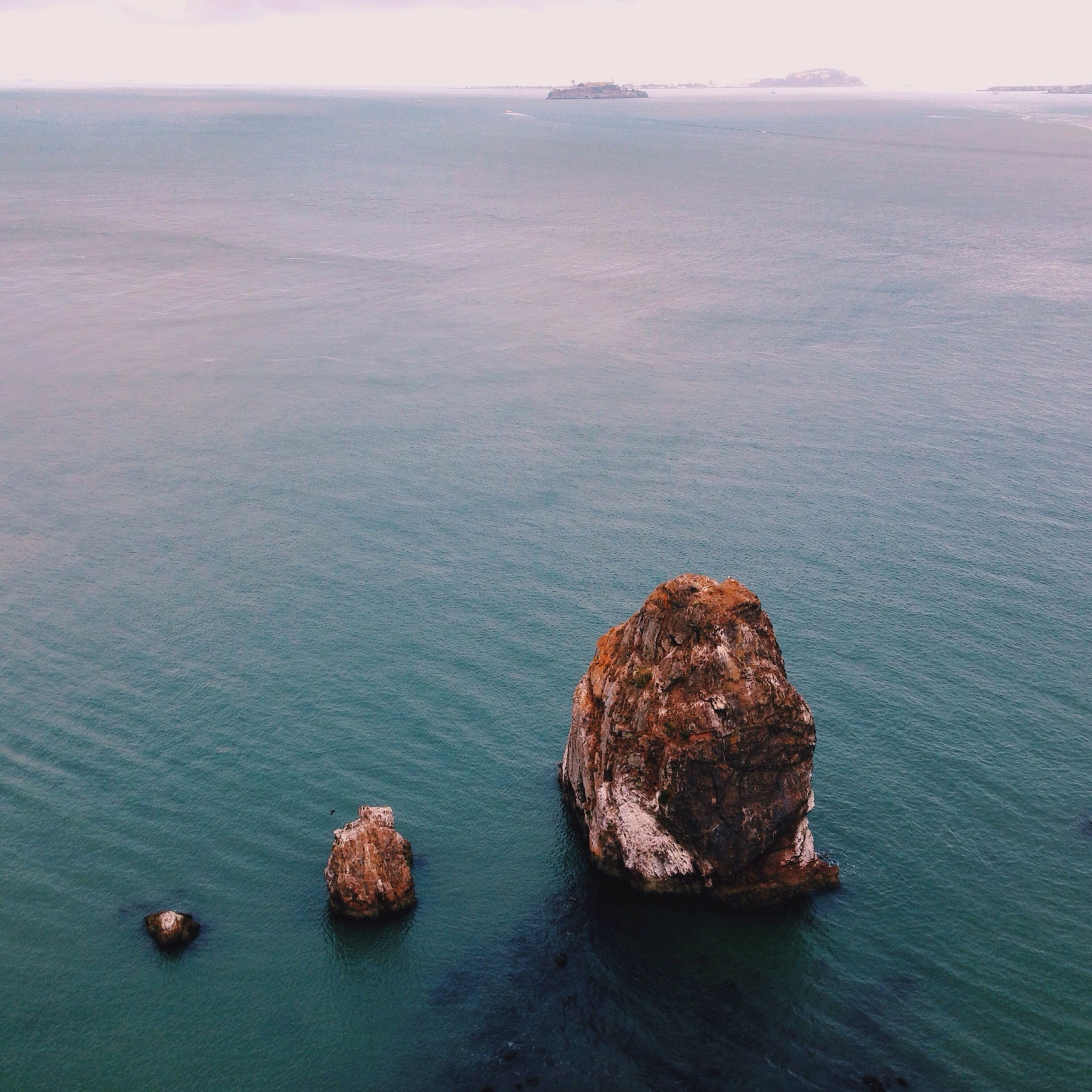 water, sea, tranquil scene, tranquility, scenics, beauty in nature, rock - object, nature, horizon over water, rock formation, rock, idyllic, sky, waterfront, blue, rippled, outdoors, no people, high angle view, day