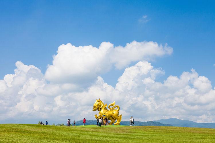 Large golden lion statue at singha park, thailand