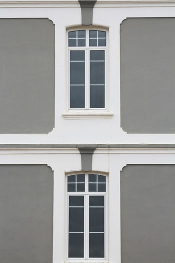 Front view of a facade painted in grey and white.