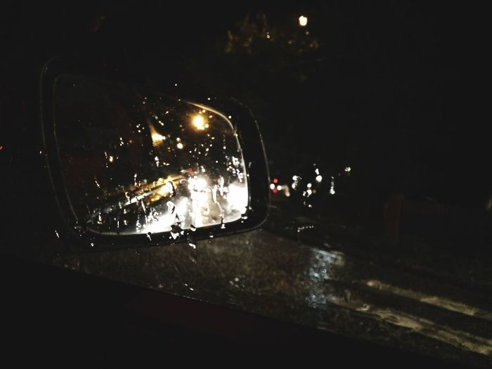 Drivingshots Amaturephotography Illuminated Night No People Lighting Equipment Mode Of Transportation Car Land Vehicle Motor Vehicle Wet Glowing Close-up Dark Glass - Material Water City Transportation Technology Street Rain