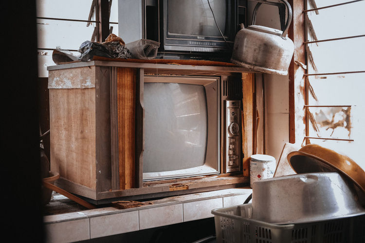 Old-fashioned television sets in room at home