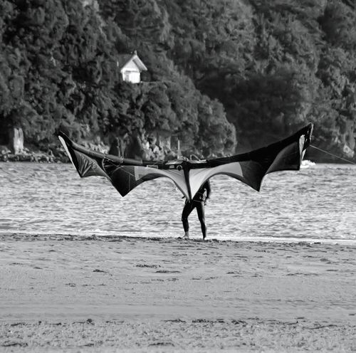 Batman paragliding Feel The Wind Blackandwhite Photography Sports Photography Seashore Outdoor Photography Bnw_friday_eyeemchallenge Monochrome Blurredbackground Shades Of Grey Shadows & Lights Paragliding Sea View Seascape Windy Ladyphotographerofthemonth From My Point Of View Capturing Freedom ReflectionsEnjoying The View Enjoying Life Capture The Moment Picturing Individuality Perfect Match Adrenaline Junkie