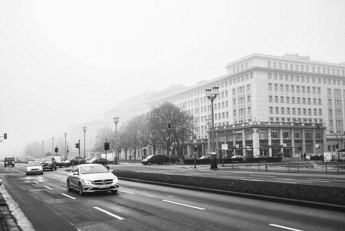 Architecture Architecture_bw Blackandwhite Blackandwhite Photography Building Exterior Built Structure Car City Clear Sky Day Focus On Foreground Foggy Foggy Weather Karl Marx Allee Land Vehicle Mode Of Transport No People Outdoors Road Sky Stralauer Allee Transportation Transportation