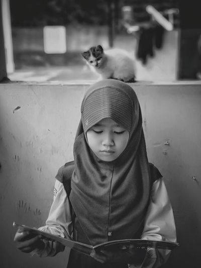 Little girls studying together