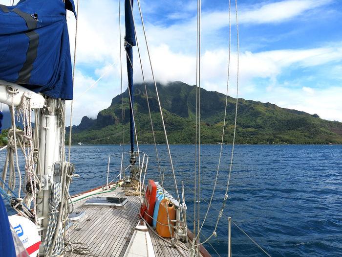 South Pacific Mooring #at Anchor #Moorea Beauty In Nature Boat Deck Cloud - Sky Day Mast Nature Nautical Vessel No People Outdoors Regatta Sailboat Sailing Sailing Ship Sea Sky Vacations Water Yacht Yachting