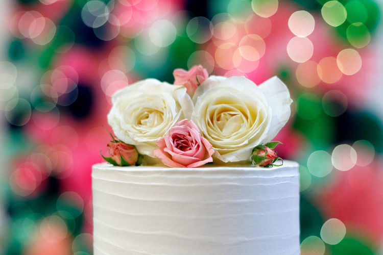 Beautiful wedding cake with flowers, bokeh background Flower Plant Flowering Plant Rosé Rose - Flower Close-up Freshness Celebration Beauty In Nature Focus On Foreground No People Event Indoors  Sweet Food Celebration Event Decoration Nature Pink Color Still Life White Color Flower Head Wedding Cake Temptation