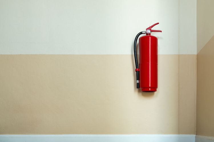 Close up of fire extinguisher on wall