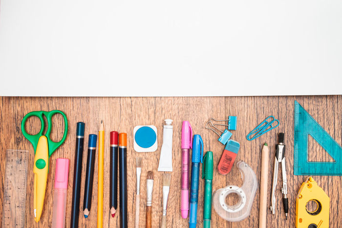 School accessories on a desktop Accessories Book Compass Copy Space Crayon Crayons Day Desktop Education Many Notebook Object Organized Pen Pencil Pencils Rubber Ruler School Scissors Still Life Study Supply Top View