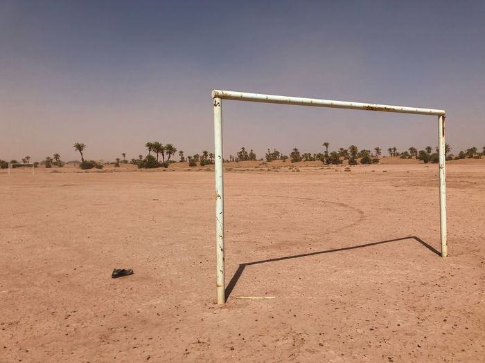 Soccerfield in the sand Neverthesame Football Everywhere TheBeautifulGame Shoe Ball Children Kids Flat Hot Palm No People Desert Sunlight Poor  Goal Land Nature Sand Sport Day Outdoors Soccer The Great Outdoors - 2019 EyeEm Awards The Street Photographer - 2019 EyeEm Awards