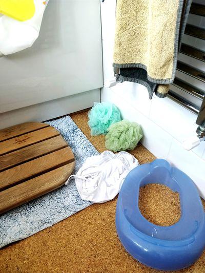 Blue Green Wooden Cork Cork Floor Toilet Seat Tiles Radiator Towel Bath Mat Bathroom Shower Curtain White Hygiene Washing Home Interior High Angle View Close-up Cleaning Sponge Scrubbing Bath Sponge