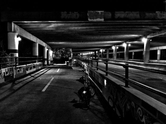 Illuminated Blackandwhite Urban Landscape Bicycle Light And Shadow