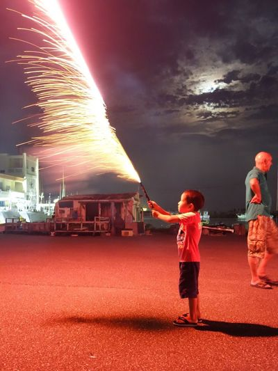 My youngest shooting a Roman candle during Obon last night.