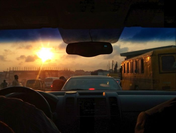 Busy streets and traffic. Through the windshield. Lagos Nigeria Busy Streets And Traffic Streetphotography EyeEm Awards 2018 People The Street Photographer - 2018 EyeEm Awards City Sunset Car Cityscape Sky Cloud - Sky Windshield Car Interior Passenger Seat Car Point Of View Windshield Wiper Vehicle Interior Dashboard Steering Wheel