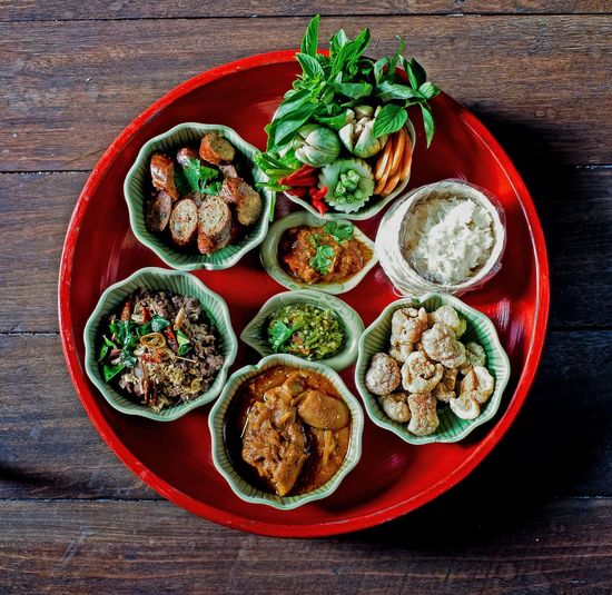 Khan tok (Northern of Thai food) Lanna Sticky Rice Thai Food Thai Sausage Plate Of Food Crispy Skin Pork Red Curry Chilli Paste Chilli Paste And Vegetable Chiang Mai | Thailand Chiangmai Thailand Northern Of Thailand Food Variation Plate High Angle View Directly Above Food And Drink