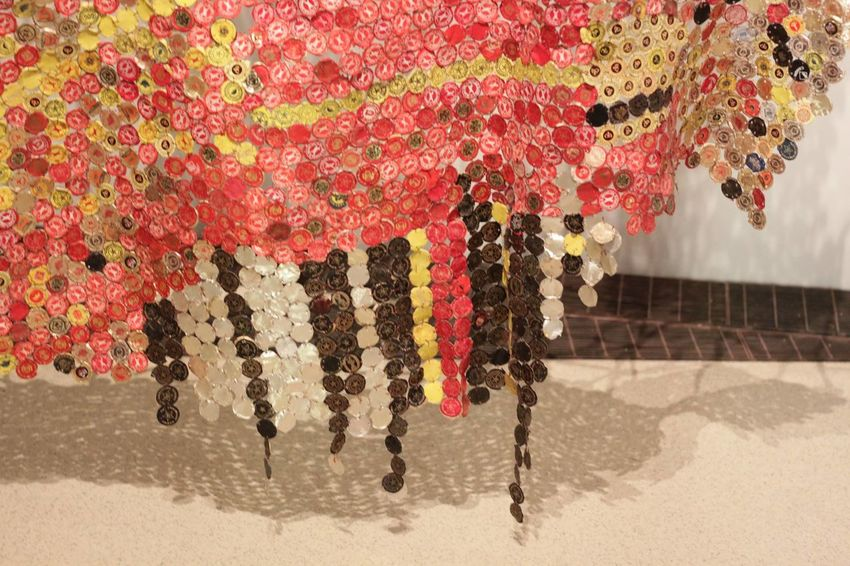 Monumental wall sculpture by El Anatsui, made of liquor #bottle tops and #copper wire Photooftheday Downtowntoronto Canada African Bottlecaps ROMToronto Movement Wallsculpture Shape Art Copper  Manument Bottle Sculpture Art And Craft Explore Yorkville Toronto Hanging Day Indoors  No People Close-up