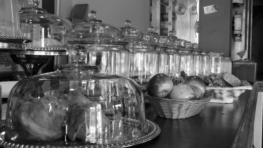 Cookies In Jars By Apples On Counter At Shop