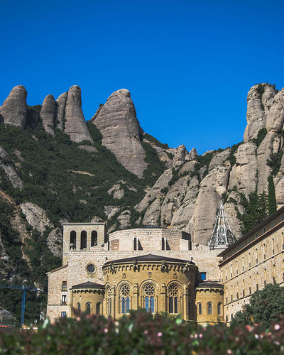 Catalunya Christian Christianity Monastery Montserrat SPAIN Architecture Building Building Exterior Built Structure Clear Sky Day History Low Angle View Monkey Monks Mountain Nature No People Sky The Past Travel Destinations