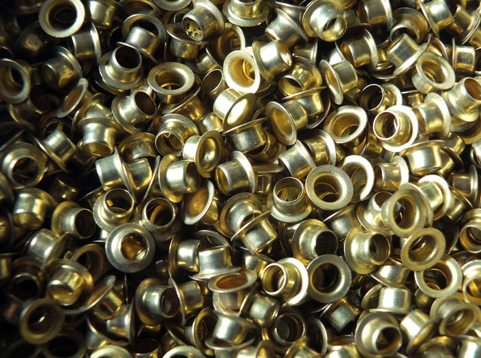brass eyelets Crafts Eyelets Backgrounds Close-up Day Full Frame Gold Colored Indoors  Industry Large Group Of Objects Metal No People Nut - Fastener Pattern Rivets