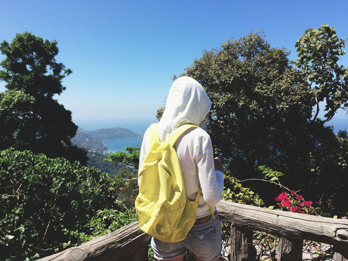 Rear View Of Backpack Woman Standing On Observation Point