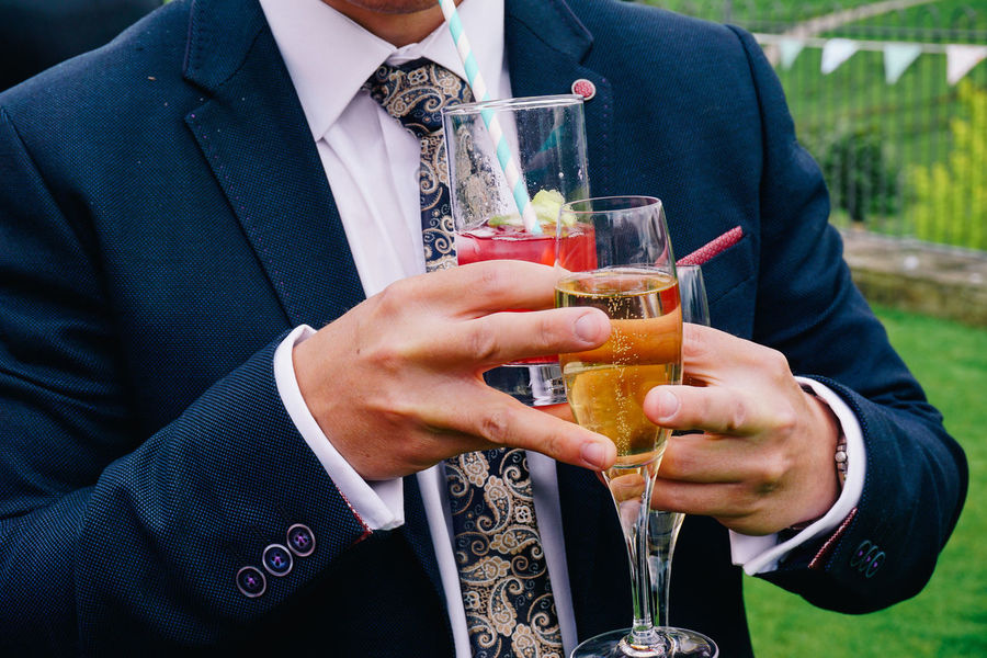 Alcohol Celebration Chic Close-up Cocktail Day Drink Drinking Glass Event Food And Drink Gentleman  Holding Juggling Occasion One Person Outdoors People Posh Real People Refreshment Style Suit Tie Wedding Well-dressed