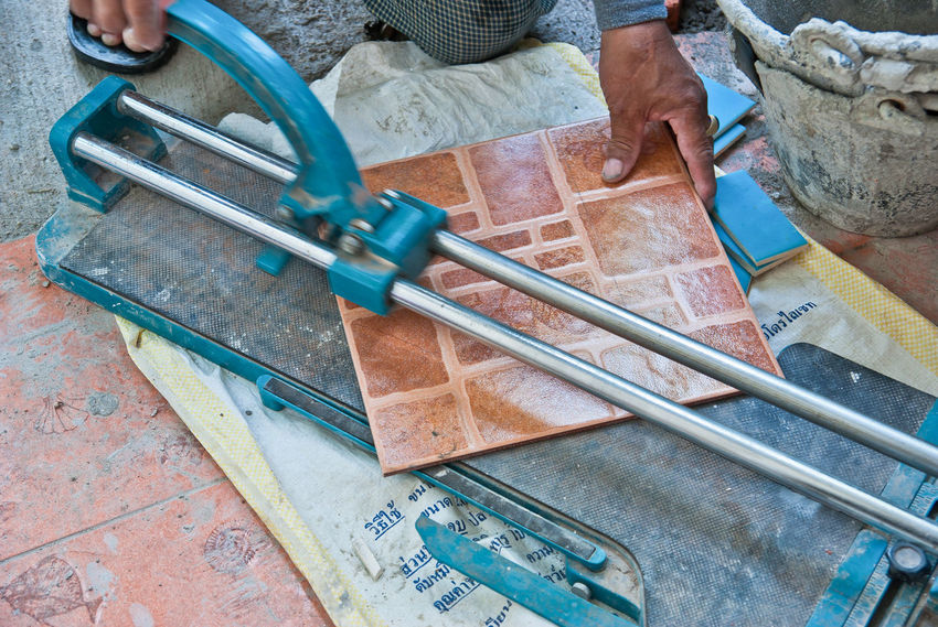Business Stories Blade Ceramic Tiles Close-up Craftman Cut Tile Cutter Equipment High Angle View One Person Skills  Worker At Work Workshop