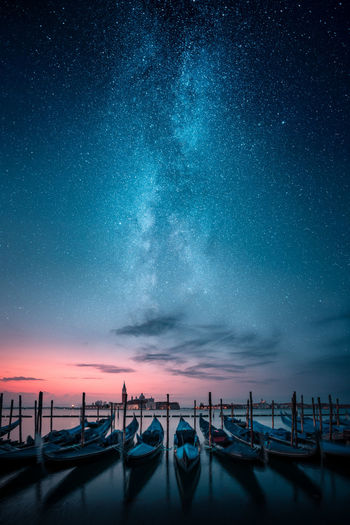 The Milky Way Series for 2018 EyeEm Awards - These are composite images made from 2-3 different shots and blended together in Photoshop by using layers and masks. My inspiration comes mainly from other photographers work that I find in social media especially from another Finnish photographer Mikko Lagerstedt's work. Although I try to have my own touch to my images. I love going out alone by the coast to see the sunset descending below horizon and to do what I love to do most.. photographing and making art. - Gondolas in a row and Chiesa di San Giorgio Maggiore in background with milky way on sky. Jamoimages 2018 EyeEm Awards Venice Italy Venezia Italia Mystical Milky Way Gondola - Traditional Boat Star - Space Stars Dawn Chiesa Di San Giorgio Maggiore Travel Destinations Travel Book Cover Book Cover Design Galaxy Fantasy Beautiful The Creative - 2018 EyeEm Awards