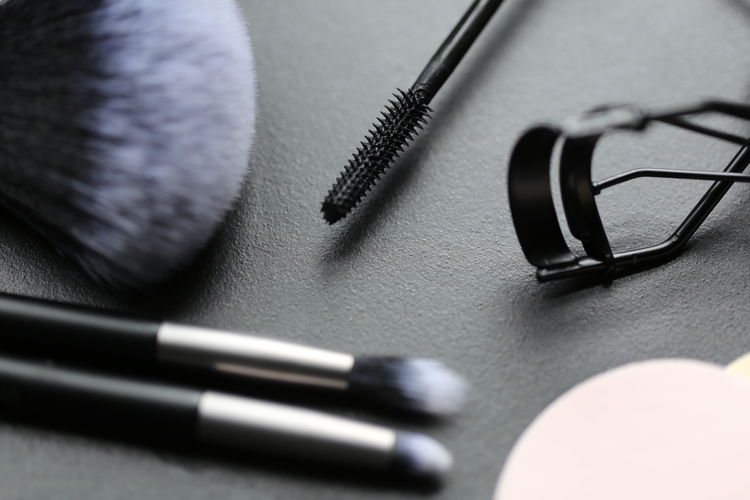 Black Color High Angle View Indoors  Close-up Still Life Table Connection Equipment Fountain Pen Communication Technology Headphones Writing Instrument Listening Pen Selective Focus No People Music Publication Personal Accessory