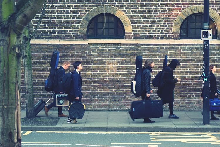 London Group Group Of People RockandRoll Rock Guitar Group Of People Architecture Men Walking Real People City Full Length People Transportation Street Outdoors Travel Day British Culture Exploring Fun Exploring Fun