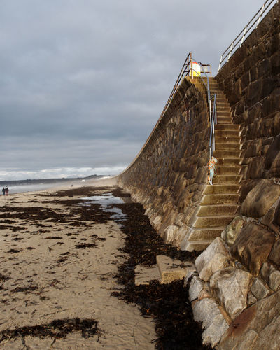 What a majestic wall and just look at that curve - how could I not take a picture or two of this wall? Architecture Beach Cloudy Day Jersey Channel Island UK Low Tide Misty Nature Outdoors People Quiet Sand Sea Defences Seaweed Sky St Ouen's Steps Still Sunny Tranquil Scene Wall Water