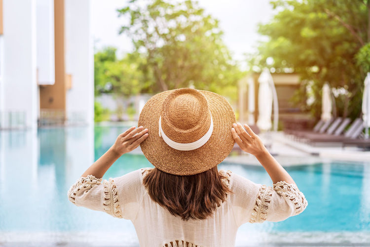 Rear view of woman wearing hat in swimming pool