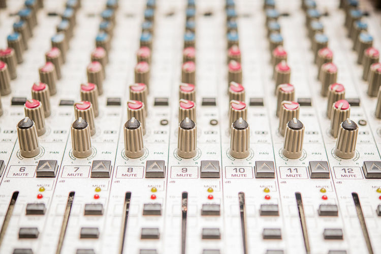 Professional music studio mixer detail close up Arts Culture And Entertainment Close-up Control Panel Day Full Frame In A Row Indoors  Large Group Of Objects Music No People Recording Studio Sound Mixer Sound Recording Equipment