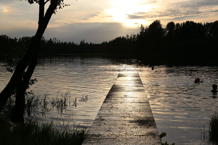 Landing stage in Lazdonas ezers in Latvia at sunset Latvia Latviasummer Pier Beauty In Nature Cloud - Sky Day Growth Lake Lake View Lake Views Lakeshore Landing Stage Nature No People Outdoors Pontoon Reflection Scenics Silhouette Sky Sunset Tranquil Scene Tranquility Tree Water
