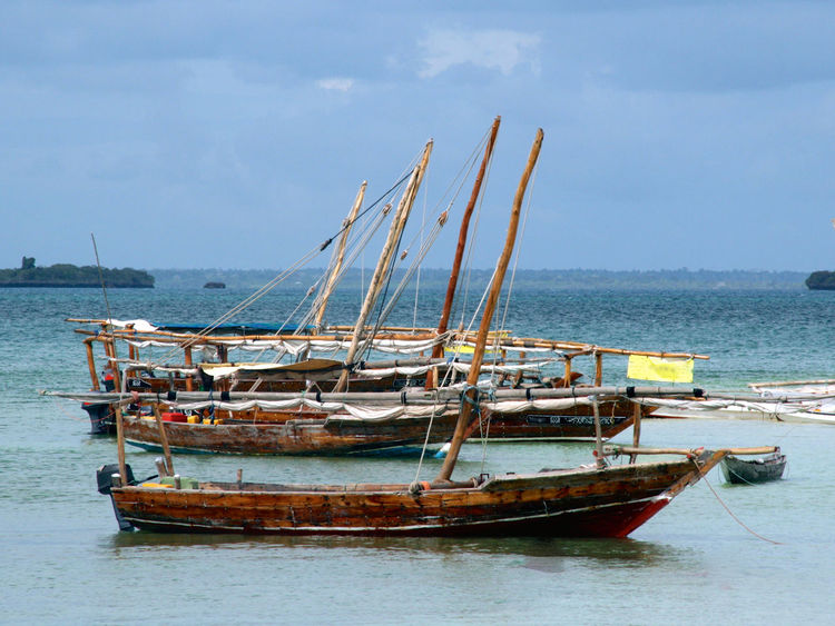 Tanzanian boats African Boat Boats Holidays Mast Mode Of Transport Moored Nautical Vessel Ocean Outdoors Residential District Sailboat Sailing Sea Summer Tanzania Tanzanian Boats Transportation Travel Vacations Water Waterfront