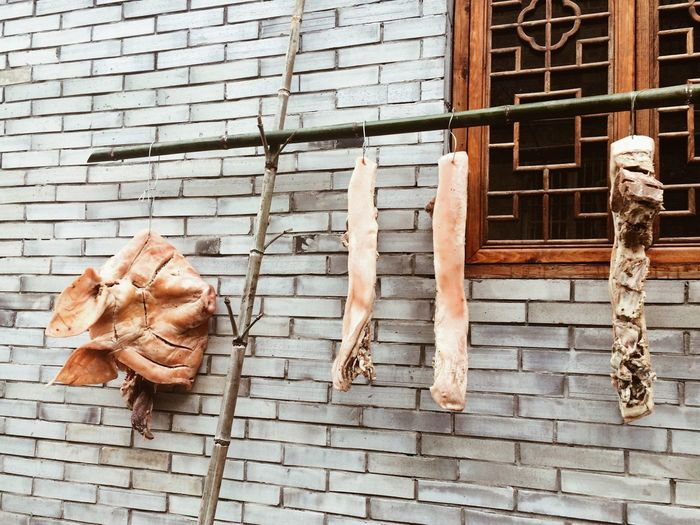 Dried Meat Hanging By Wall At Market Stall