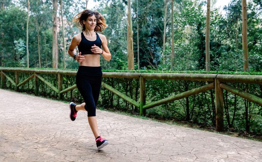 Full length of woman running on walkway