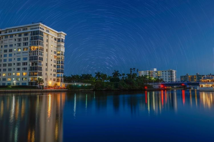 I love where I live 😍. Reflection Water Reflections Long Exposure Water Sky Building Landscape Beautiful Night Nightphotography Night Lights Taking Photos Stars Skyporn Architecture Enjoying Life Check This Out Streetphotography City Escaping Simplicity Light Hello World Nature Cities At Night