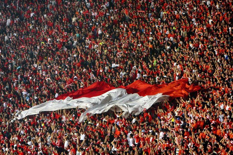 Spectator With Indonesian Flag At Soccer Stadium
