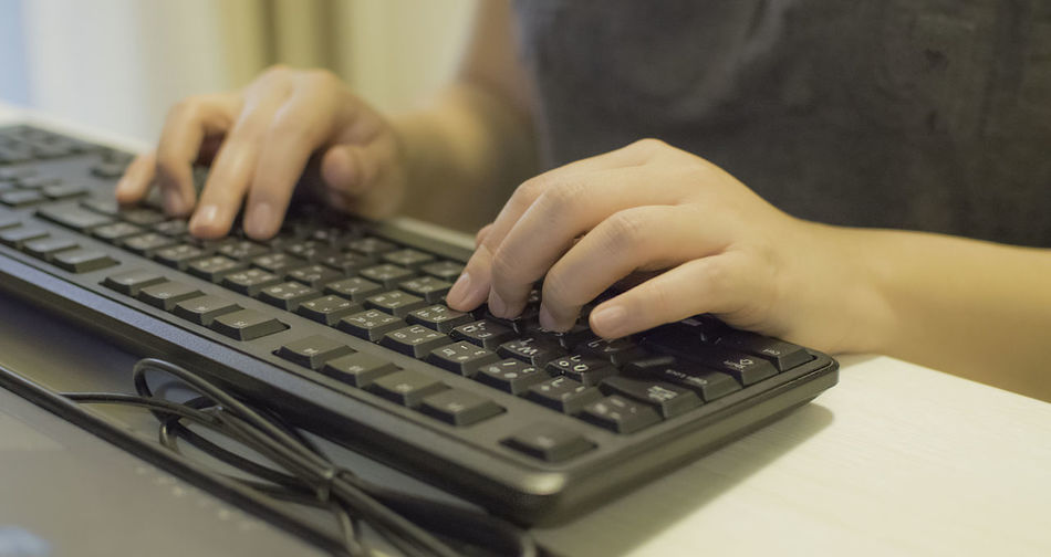 Midsection Of Woman Typing On Keyboard