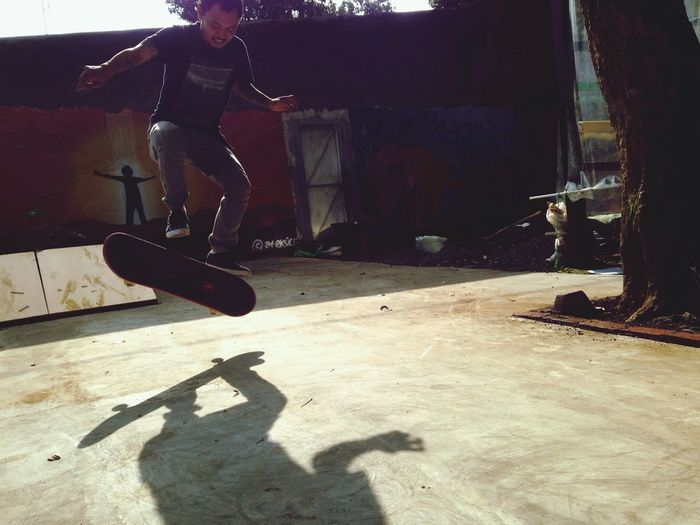 tessa one of the leader of youth programme at rumah cemara doing a kick flip. Skate Skate Life Kickflip