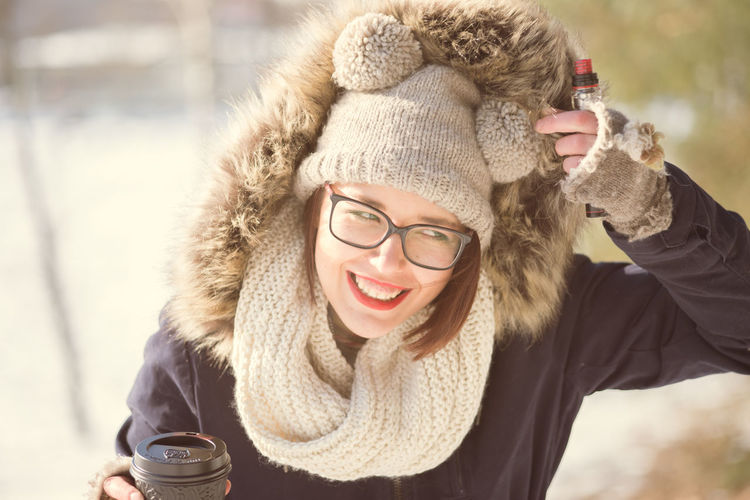 Cheerful Coffee - Drink Coffee Cup Cold Temperature Day Drinking Eyeglasses  Focus On Foreground Front View Fur Happiness Headshot Knit Hat Leisure Activity One Person Outdoors Portrait Real People Scarf Smiling Toothy Smile Warm Clothing Winter Young Adult Young Women