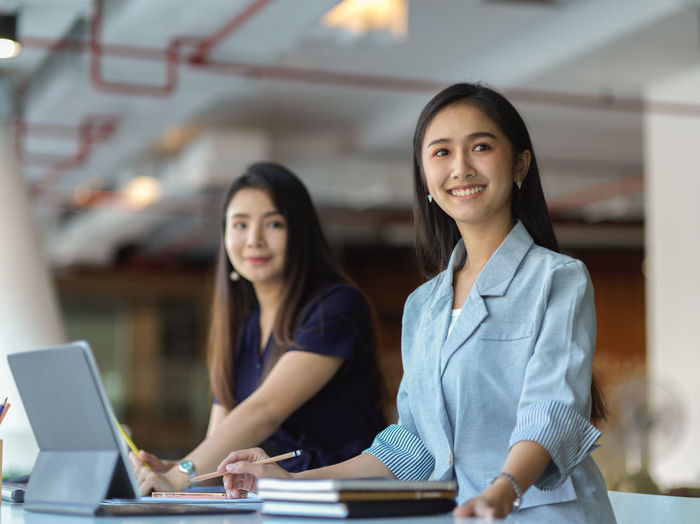 Smiling businesswomen working at office