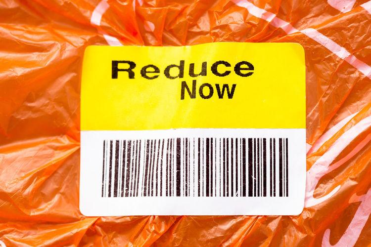 Reduce Now plastic pollution bar code label on plastic bag End Plastic Pollution Warming Bar Code Business Climate Change Close-up Communication Consumerism Container Food For Sale Label Number Orange Color Package Packet Paper Plastic Plastic Bag Pollution Price Tag Retail  Still Life Text Yellow
